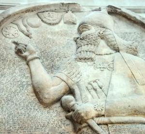 Ashurnasirpal stela, British museum, with stellar/solar/lunar symbols and Akkadian cunieform script.