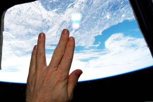 Astronaut Terry W. Virts uses the Vulcan Salute from the International Space Station. Below is Boston, USA, where Leonard Nimoy was born. Image: NASA