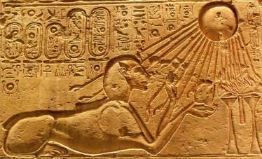 Akhenaten, Pharaoh of Ra, depicted in leonine sphinx form, receiving the 'touch of Ra's hands'.